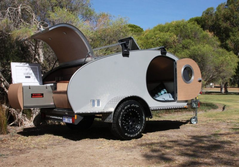 Expanding Australian camping trailer pops, folds and swings to circle of relatives size