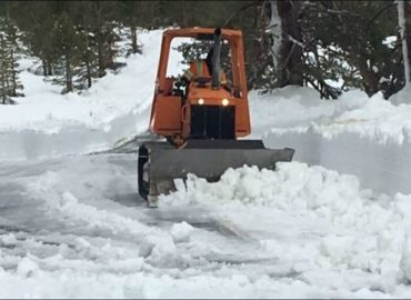 Wait, it's May! Highways closed in Sierra, chains required for mountain journey