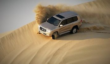 Dune bashing on a desert safari in Qatar